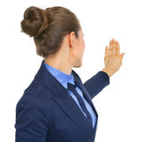 Business woman pointing on copy space. rear view Stock Photos