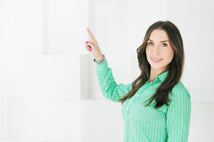 Business woman pointing at copy space on white background Stock Photo