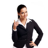 Business woman pointing at copyspace. A young beautiful business woman pointing at copyspace Royalty Free Stock Image