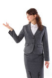 Business woman pointing at copyspace. Young beautiful business woman pointing at copy space isolated over white Stock Photography
