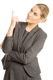 Business woman pointing at copyspace.  Royalty Free Stock Photo