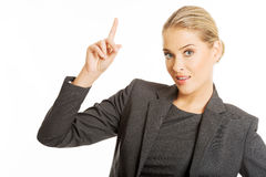 Business woman pointing at copyspace.  Royalty Free Stock Photography