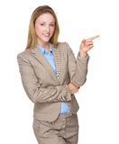 Business woman pointing at copyspace. Isolated on white background Stock Photo