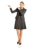 Business woman pointing at copyspace on the left Royalty Free Stock Photo