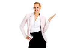 Business woman pointing for copyspace or something.  Stock Photo