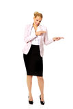 Business woman pointing for copyspace or something. Businesswoman pointing for copyspace or something Royalty Free Stock Photography