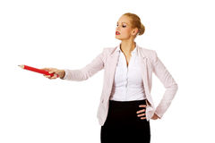 Business woman pointing for copyspace or something with huge pen.  Stock Photo