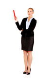 Business woman pointing for copyspace or something with huge pen.  Royalty Free Stock Photography