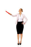 Business woman pointing for copyspace or something with huge pen Stock Photo