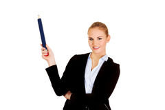 Business woman pointing for copyspace or something with huge pen.  Royalty Free Stock Photos