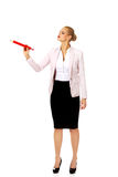 Business woman pointing for copyspace or something with huge pen Stock Photos