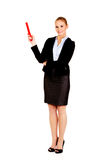 Business woman pointing for copyspace or something with huge pen.  Stock Photography