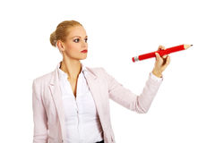Business woman pointing for copyspace or something with huge pen.  Royalty Free Stock Image