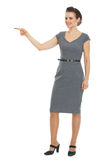 Business woman pointing in corner Stock Photography