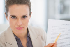 Business woman pointing on document Royalty Free Stock Photo