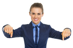 Business woman pointing down on copy space Stock Photo