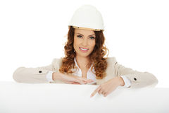 Business woman pointing on empty banner. Royalty Free Stock Images