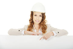 Business woman pointing on empty banner. Royalty Free Stock Photo