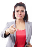 Business woman pointing finger at you with focus on the finger Royalty Free Stock Photography