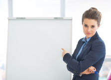 Business woman pointing on flipchart Stock Photos
