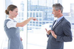 Business woman pointing her colleague Royalty Free Stock Images