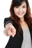 Business woman pointing her finger. Picture of attractive business woman pointing her finger, isolated over white Stock Images