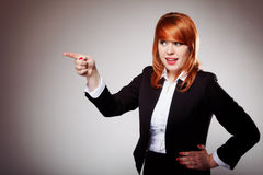 Business woman pointing her finger against someone Stock Photography