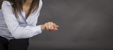 Business woman pointing her finger on imaginery virtual button Royalty Free Stock Image