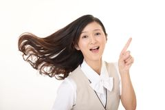 Smiling business woman. Business woman pointing with her finger Stock Photography