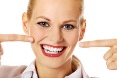 Business woman pointing at her happy smile Stock Photos