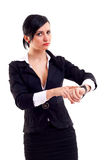 Business woman pointing her watch Stock Photos