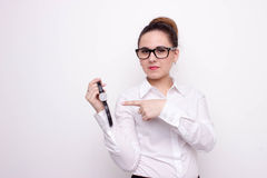 Business woman pointing her watch Stock Photo