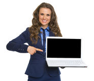 Business woman pointing on laptop blank screen Stock Image