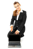 Business woman pointing on laptops blank screen Royalty Free Stock Image