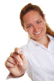 Business woman pointing with pen Royalty Free Stock Photos