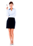 Business woman pointing with a pen Stock Image