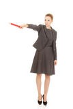 Business woman pointing with pencil. Royalty Free Stock Photo