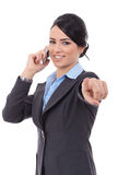 Business woman pointing on the phone Royalty Free Stock Photography