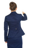 Business woman pointing. rear view Royalty Free Stock Image