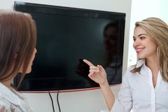 Business woman pointing at a screen Stock Photos