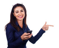 Business woman is pointing a side on white Stock Image