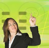 Business woman pointing at something on screen - green Stock Images