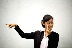 Business woman pointing and telling stock image