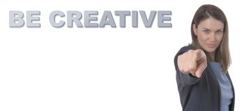 Business Woman pointing the text BE CREATIVE. Business Concept Stock Images