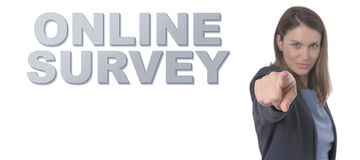 Business Woman pointing the text ONLINE SURVEY CONCEPT. Business Concept Stock Photo