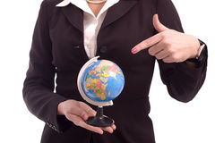 Business woman pointing to an earth model Stock Photography