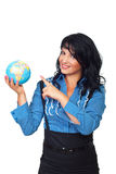 Business woman pointing to globe Stock Photo
