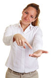Business woman pointing to her palm Royalty Free Stock Photos