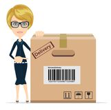 Business woman pointing to a large cardboard box. Stock Photography