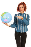 Business woman pointing to world globe Royalty Free Stock Images